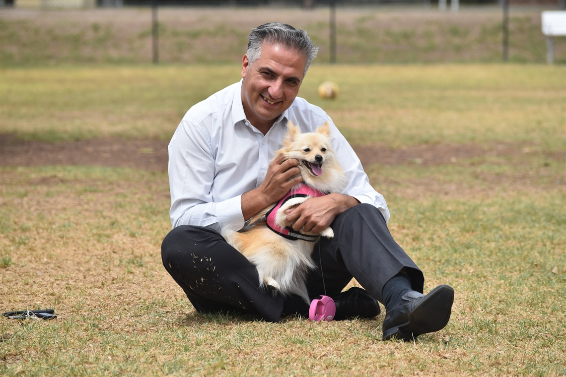 Picture of Mayor Frank Carbone with dog at a dog park